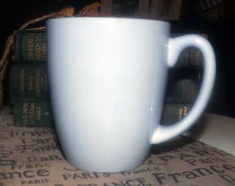 Corelle Bahia pattern all-blue stoneware coffee or tea mug made circa 2006-2009 and now discontinued.