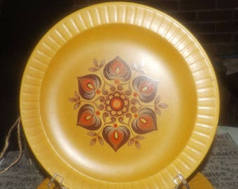 Vintage (1960s) Herbert Aynsley retro stoneware dinner plate. Brown floral medallion center made in England. Sold individually.
