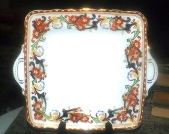 Antique (1890s) Delphine England numbered handled | lugged square Imari cake | cookie serving plate. Rust, yellow, blue flowers, gold.