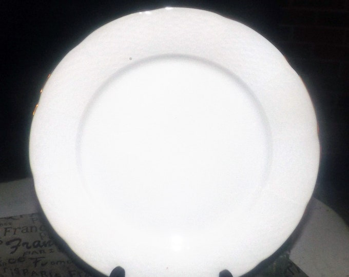 Vintage (1960s) Thun THU407 all-white dinner plate. Basket weave embossing, gold edge. Made in Czechoslovakia. Minor flaw (see below).