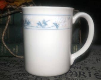 Vintage (1980s) Corelle | Corning USA | Corning Ware First of Spring mug. Gently embossed blue-&-white florals. Made in USA.