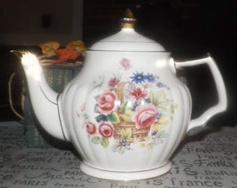Early mid-century (1940s) Sadler 3540 hand-decorated teapot with lid.  Flowers in basket, abundant gold edge and accents.