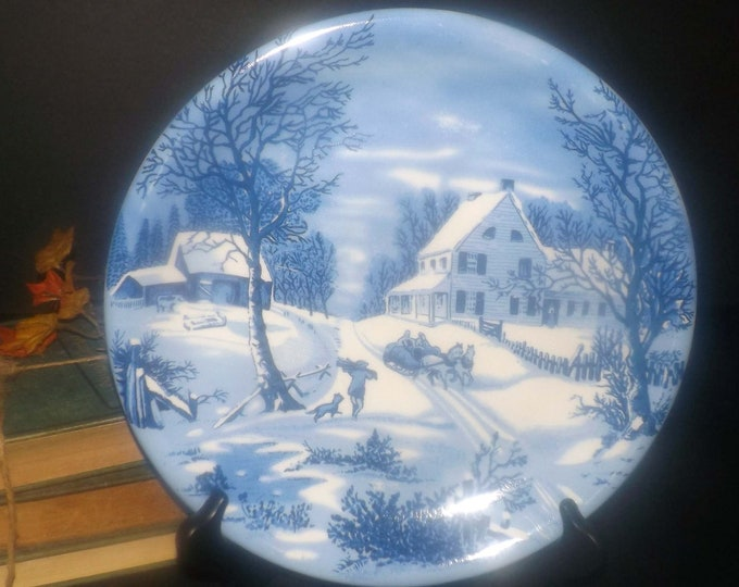 Vintage blue-and-white Currier & Ives Christmas large dinner plate | charger. Horse sleigh, boy, dog winter landscape imagery.