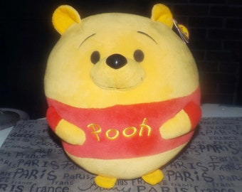 Vintage large, plush Winnie the Pooh. Original tags.