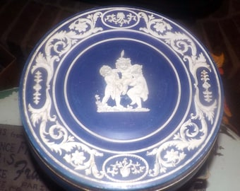 Early mid-century (late 1940s) Huntley & Palmers cookie tin. Greek theme, blue, white lithographed tin. Cherubs front and center.