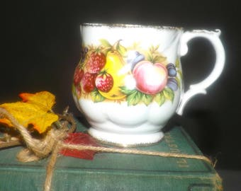 Vintage (1960s) Queens China England | Rosina China Antique Fruit series footed orphaned cup (no saucer). Multicolored fruit, gold edge.