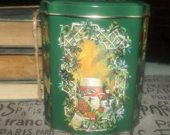 Vintage (1982) Avon Christmas metal candy | bon-bon tin, tea caddy or spice jar. Made in England. Green, gold Christmas imagery, multi-sided