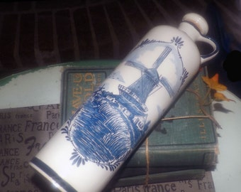 Vintage (1960s) Delftware   Delft Blawu tall lidded oil or vinegar jug.  Hand-painted windmill flowers. Numbered to base.