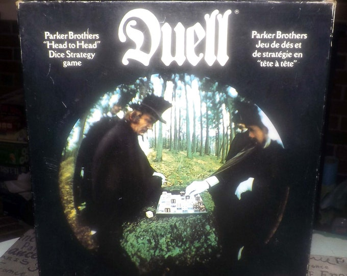 Vintage (1976) Duell dice game published by Parker Brothers. Bilingual (Eng | French) Canadian version. Complete.