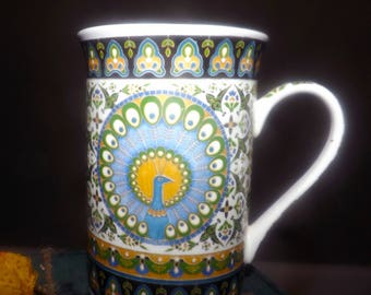 Vintage (1980s) Thun Karlovasky bone china mug. Peacock, feathers fully aplume. Geometric border band. Made in Czechoslovakia