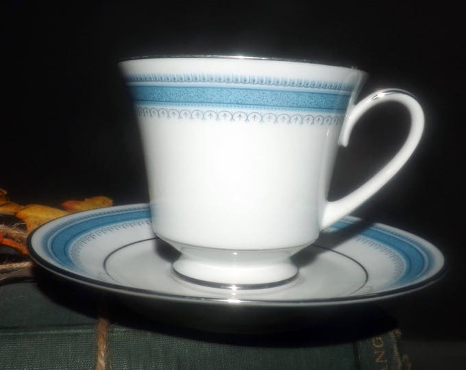 Vintage (1980s) Noritake Pembroke pattern 2892 tea set (footed cup with saucer). Blue bands and dots, platinum edge.