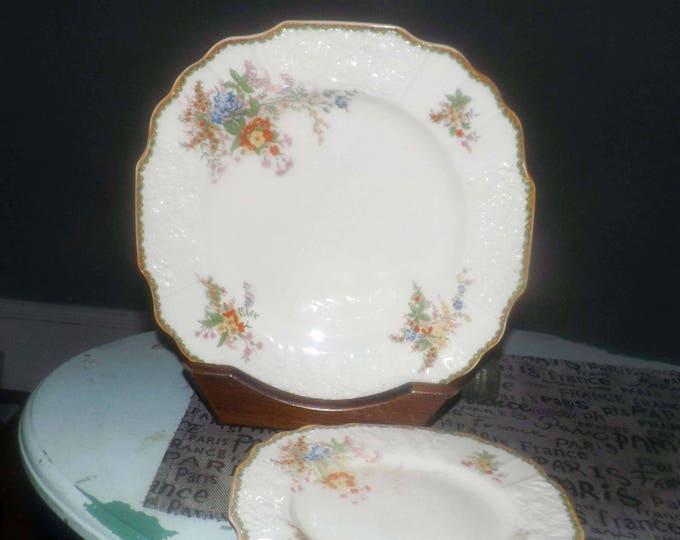 Pair of quite vintage (1930s) Myott Devon floral creamware plates: 1 salad, 1 dinner. Flawed (see below).