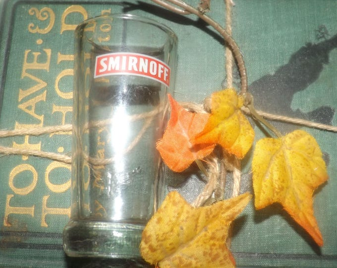 Vintage (1980s) Smirnoff Vodka branded single shot | shooter glass.  Etched and embossed Smirnoff wording and logo.