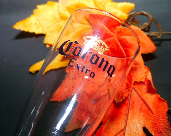 Vintage (1980s) Corona Extra tapered pilsner glass. Etched-glass Corona branding weighted base. Commercial quality glassware.