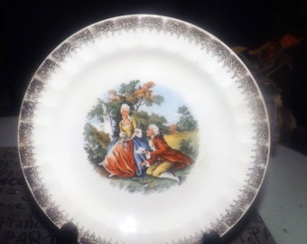 Vintage (1960s) Cronin China Co. Minerva Ohio George and Martha Washington romance scene plate.  Made in USA.