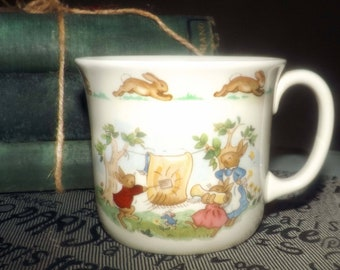 Mid-century Royal Doulton Bunnykins baby | child | toddler cup | mug featuring bunnies doing various chores. Made in England.