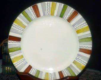 Vintage (1960s) Broadhurst Mandalay dinner plate designed by Kathie Winkle. Brown, yellow, green geometric. Minor flaw (see below).