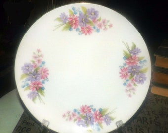 Vintage (1970s) Leuco Fine China Japan dinner plate. Pink, purple florals, smooth gold edge.