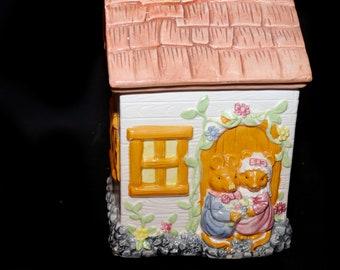 Vintage (1990s) Cottage cookie jar. Mouse couple, Mice bride and groom in doorway of country cottage. Flaws (see below).