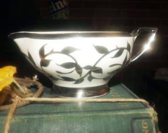 Early mid-century (1954) Myott Old Silver Luster 1505F hand-painted creamer or milk jug. Broad platinum bands, platinum leaves.