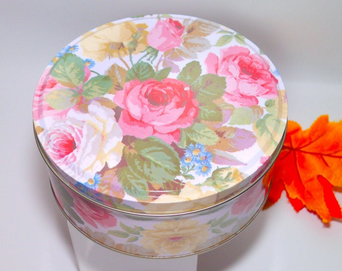 Vintage (1970s) round cake or cookie tin. Pink and yellow roses. Made in Taiwan.
