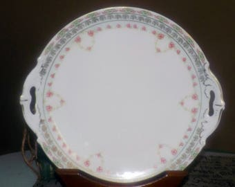 Antique (early 1900s) MZ Austria   Moritz Zdekauer   Altrohlau handled cake serving plate. Pink rose swags, golden leaves.