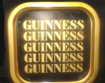 Vintage (1980s) Guinness square metal bar tray.  Black with gold Guinness wording and gold rim.