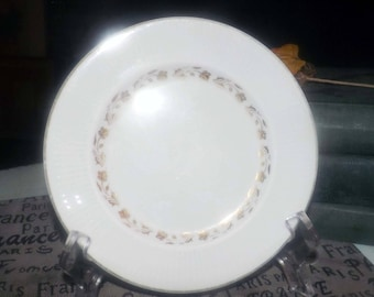 Vintage (1960s) Royal Doulton Fairfax TC1006 bread-and-butter or side plate. Gold flowers, leaves, ribbed verge. Flawed (see below).