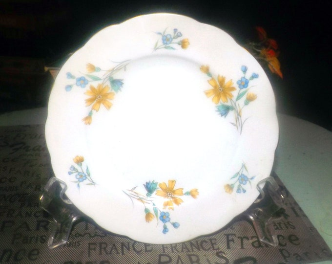 Pair of vintage (1970s) Cmielow bread-and-butter or side plates. Blue, yellow flowers, scalloped, gold edge. Slight flaw (see below).