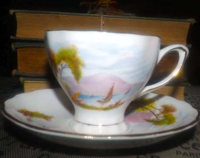 Vintage (1960s) Colclough 1646 hand-decorated tea set (footed cup with matching saucer). Red mountain and sailboat scene.  Pretty.