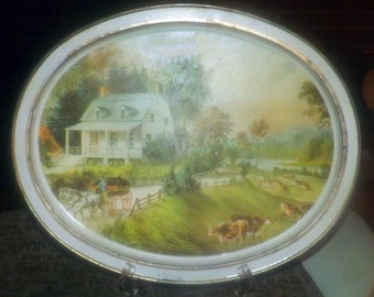 Vintage (1960s) American Homestead Summer Currier & Ives oval metal tray.  Americana homestead, cows in the field.