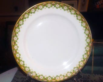 Quite vintage (c.1930s) Jean Pouyat Limoges hand-decorated art-deco luncheon plate. White daisies on a green band, pops of black, gold edge.