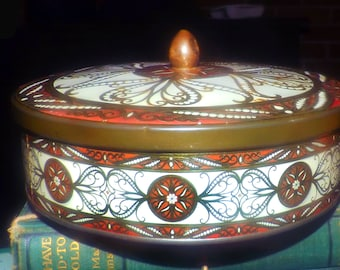 Early mid-century (attributed 1940s) round, ornately lithographed cookie | biscuit tin.  Made in England.