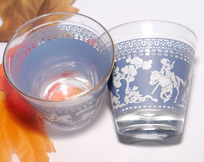 Pair of mid-century Hazel Atlas Arabian Knights Wedgwood Blue etched-glass loball old fashioned glasses. Knights on horseback, gold rim.