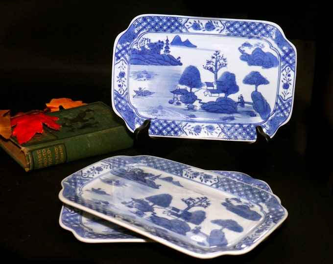 Vintage (1960s) Chinoiserie Blue Willow blue-and-white Oriental motif sandwich platter. Sold individually.