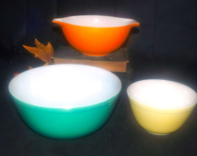 Vintage Pyrex mixing and cinderella bowl set. Colorful kitchen accents in orange, green, yellow. Vintage glassware made in the USA.