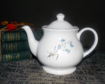Vintage (1980s) large Sadler teapot.  All white with blue florals and greenery, a gold edge and gold accents.