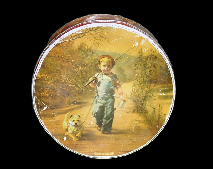 Vintage (1930s) McVitie & Price The Optimist round cookie tin. Young boy and his dog go fishing. Made in England.
