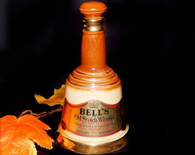 Vintage (1960s) Bell's 70-proof Scotch Whisky small, bell-shaped stoneware toby jug.  Original labels. Made in England by Wade-Heath.