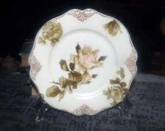 Almost antique (1920s) Hermann Ohme Silesia Old Ivory 82 hand-painted, numbered salad or side plate. Yellow roses, embossed gold scrolls.