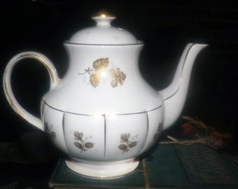 Mid-century (early 1950s) Arthur Wood England 5319 hand-decorated teapot with lid.  Gold, blue florals, ribbed body.