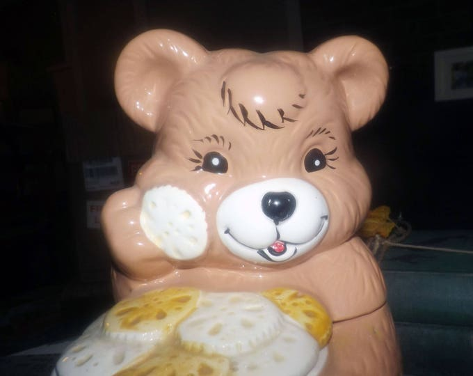 Vintage (1970s) figural cookie jar. Pink teddy bear with a plate full of cookies!  Made in Taiwan and attributed to Giftcraft.