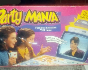 Vintage (1993) Party Mania VHS board game. Teenage dating game published by Parker Brothers.  Complete.