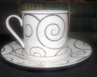 Vintage (1992) Gold Swirl cup and saucer. Gold scrolls on white. Exclusive to Pier 1 in Canada.