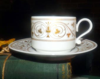 Vintage (1980s) Heinrich Germany | H&C Co. bone china cup | coffee can and with saucer. Gold scrolls, florals, leaves on white.