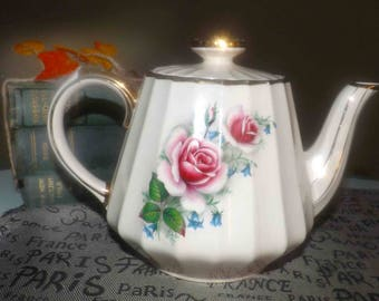 Vintage (1960s) Sadler England teapot featuring pink and white roses, blue flowers and greenery, swirled body, gold edge and accents.