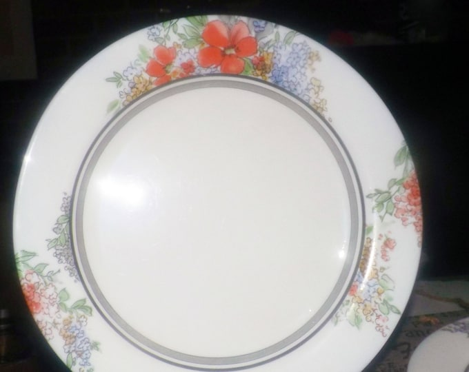 Vintage (1980s) Arcopal France large, glass dinner plate | charger. Orange and blue flowers, black and grey bands on white.