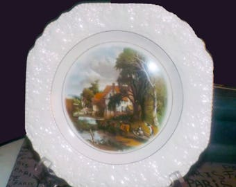 Vintage (1960s) Lord Nelson Pottery | Lord Nelson Ware creamware display plate. Central image of Valley Farm by John Constable, gold edge.