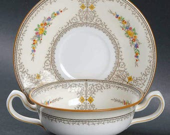 Almost antique (1912-1920) Mintons   Minton Sheridan hand-painted double-handled cream soup cup and saucer. Florals, brown scrolls, edge.