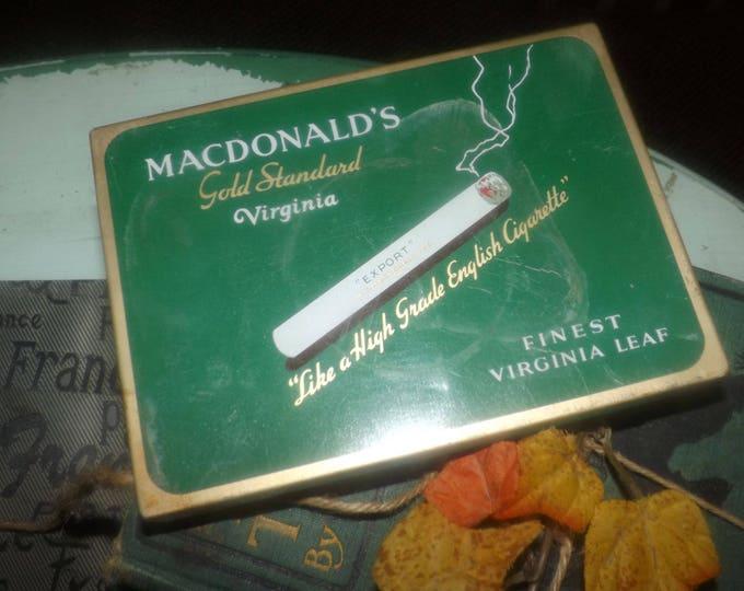 Vintage (1960s) MacDonald's Gold Standard Virginia Cigarettes hinged-lid tin. W.C. MacDonald Tobacco Montreal.